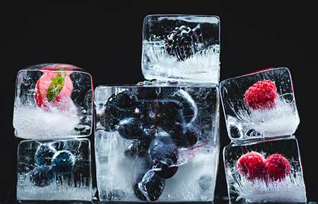 Ice With Frozen Fruit Ready To Be Blended