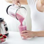 Woman Using A Glass Blender