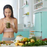 Woman Drinking Green Smoothie Fresh From Blender