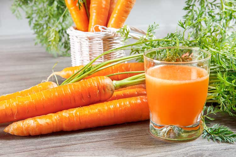 Carrots And Glass Of Juice For Healthy Skin