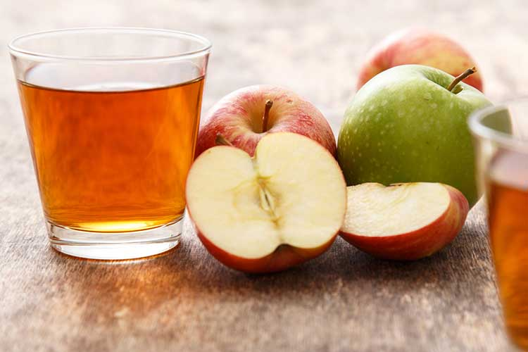 Apple Juice ready to be drank for its benefits