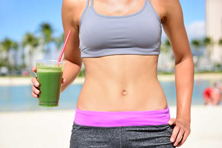 Woman Running With Green Juice