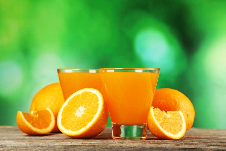 Oranges, Orange Juice and a Green Background
