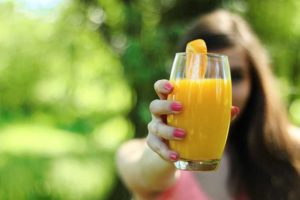 Girl Drinking juice in morning