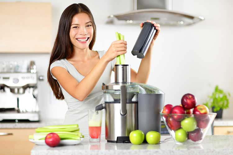 Woman Using Centrifugal Juicer